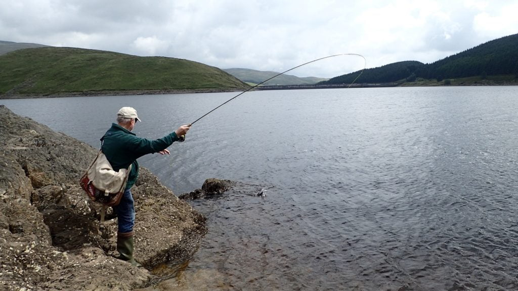 George Barron playing a trout